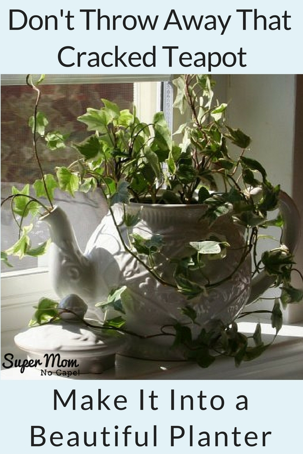 Planter made from a white teapot with an ivy plant in it sitting on a window sill.
