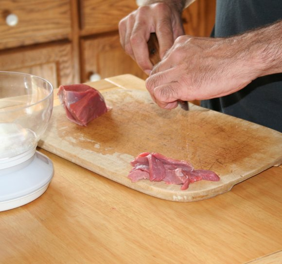 Slicing meat into strips for stir fry