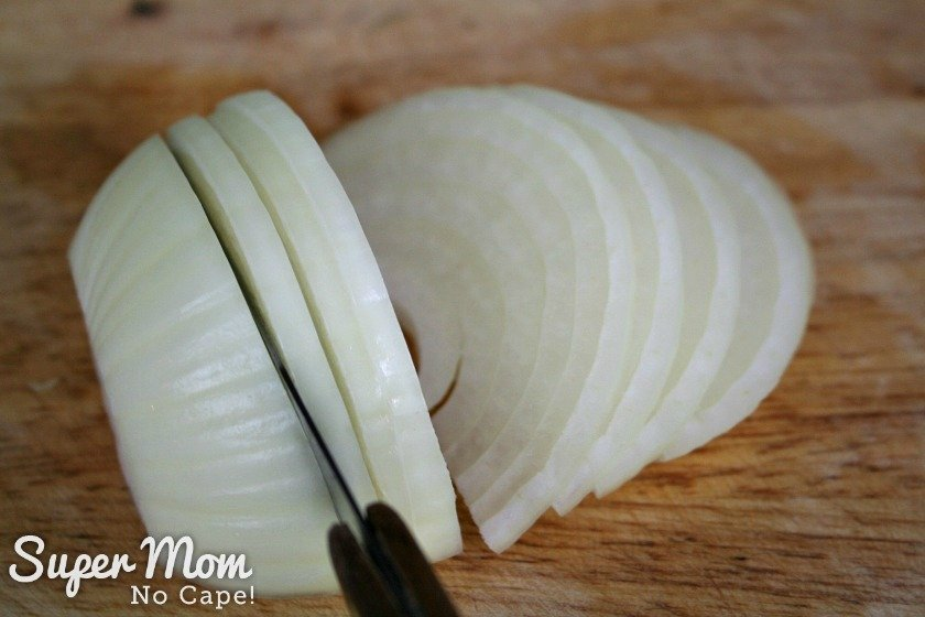 Slicing the onions into quarter inch slices