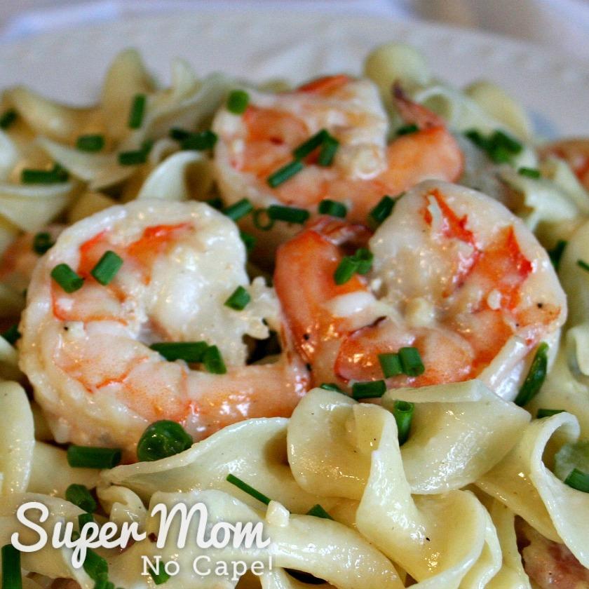 Shrimp on top of pasta in Creamy Shrimp Pasta Recipe