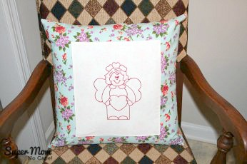 How to Sew a Basic Throw Pillow Tutorial - front view with the added embroidered center.