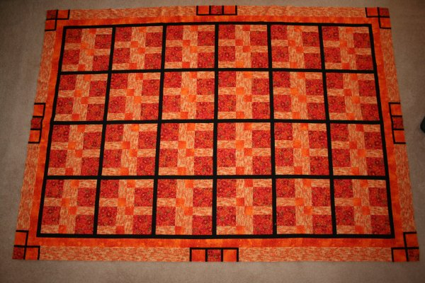 Disappearing Nine Patch Quilt complete with borders