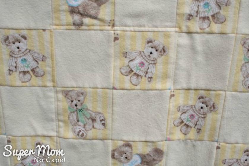 How to Make Bedding for a Doll Cradle - finished doll quilt close up