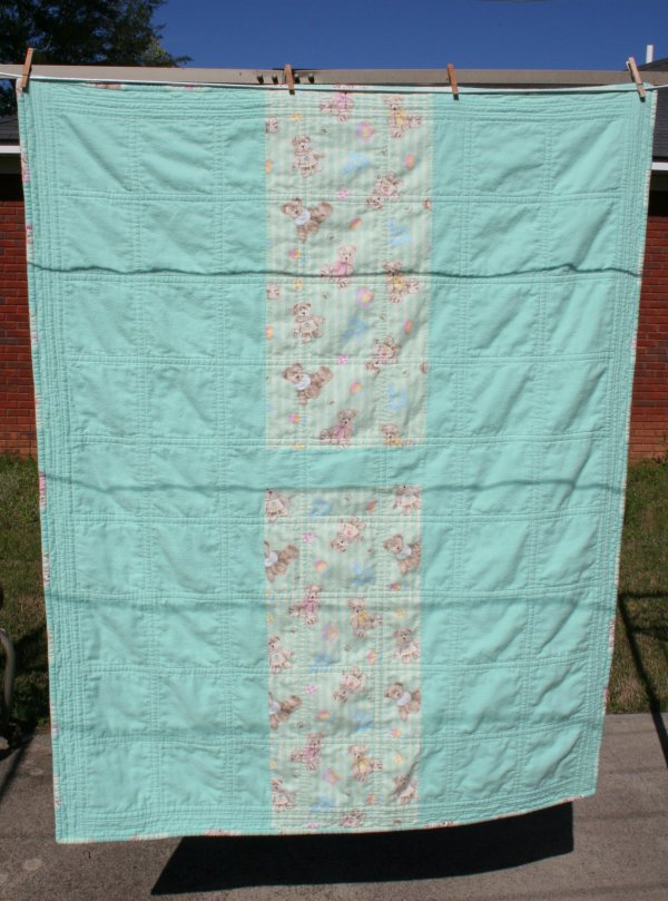 This is the back (complete with shadows of the other clotheslines.) Next time I'll remember to turn the quilt around before photographing the back.