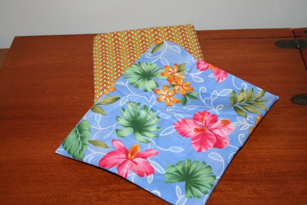 This fabric reminded me of Hawaii.  I'm going to make an apron with it and pair it with the fabric underneath.