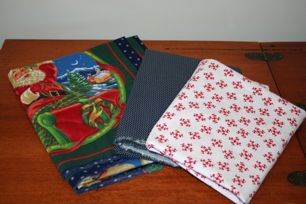 Santa pillow panels to be used for a gift. The red and white to paired with redwork embroidery pieces and the blue with white dots just because it never hurts to have that kind of thing in your stash.