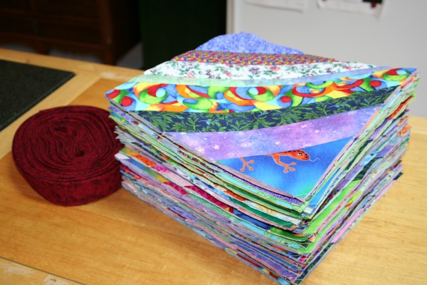 35 QAYG blocks and roll of binding
