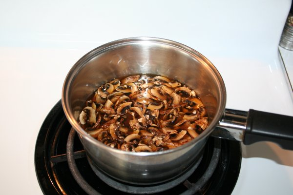 Rehydrate mushrooms in beef broth