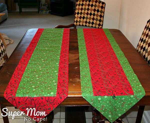 Two red and green One Hour Table Runners with one being the reverse of the other