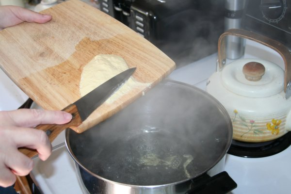 Use knife to cut dough into water