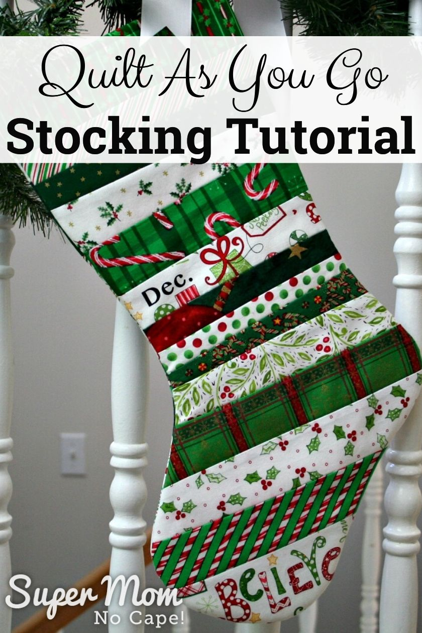 Quilted Christmas stocking hung from a bannister with pine boughs