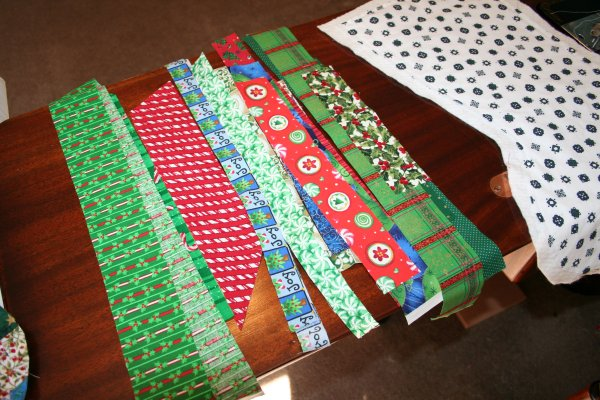 Several strips of Christmas fabrics