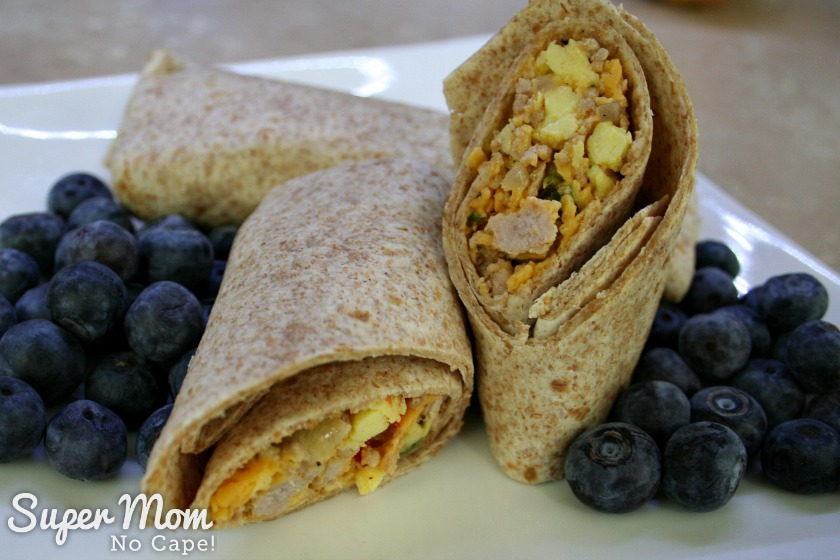 Homemade Breakfast Burrito served with blueberries on a white plate