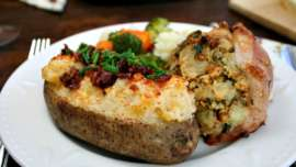Twice Baked Potatoes served with stuffed pork chops and veggies