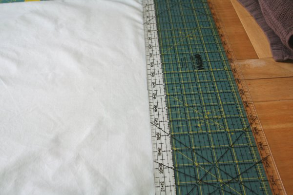 measure one inch from end of pillow case