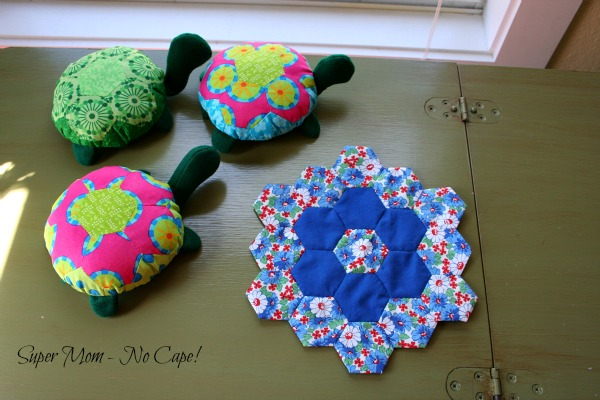 Photo of three hexie turtles and blue hexie flower