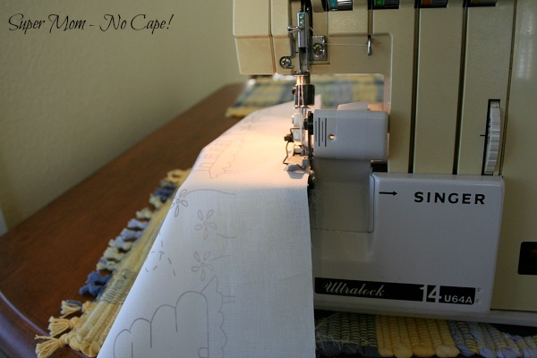 Serging the edges of the embroidery