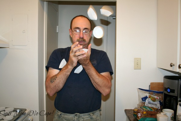 Photo of Dave blewing apart muffin liners