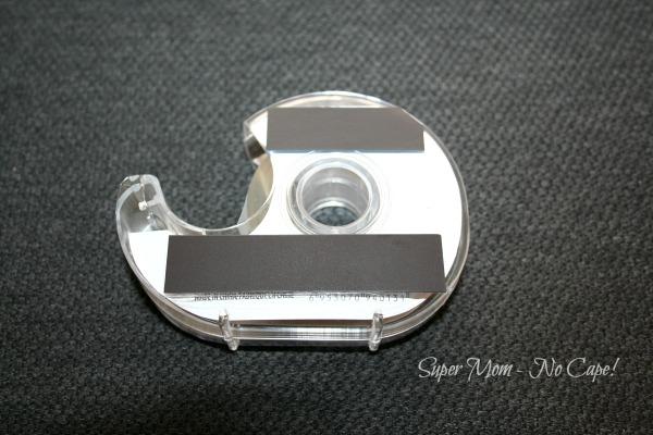 Strips of magnet applied ot back on tape dispenser