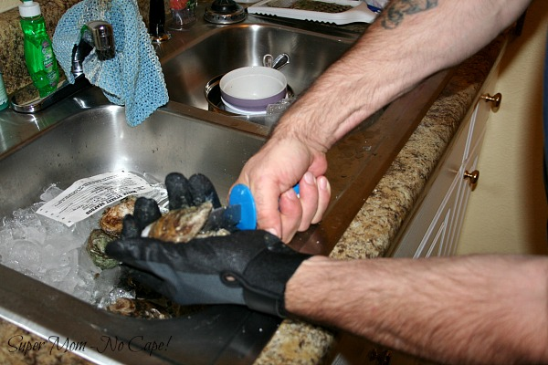 Photo of oyster being shucked