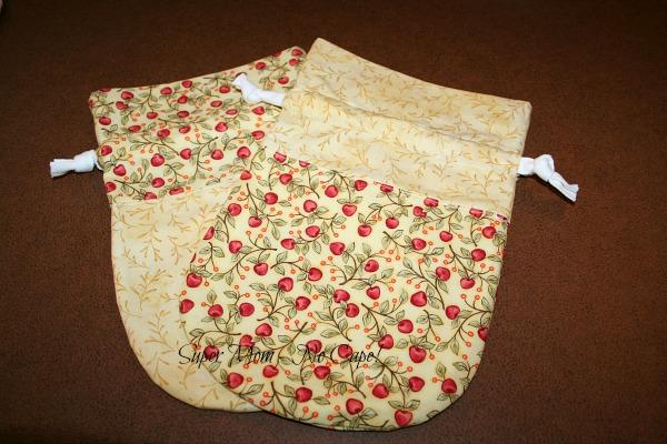Photo of cherries and yellow drawstring bags