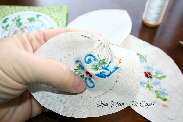 Gather the fabric using a running stitch