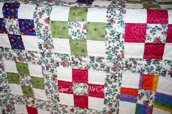 Close up of straight line stitching on Nine Patch quilt.