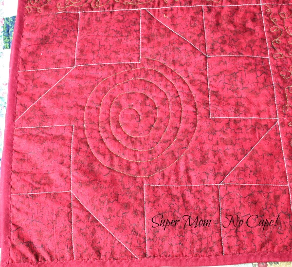 Back of Paper Pinwheel block with the spiral quilting