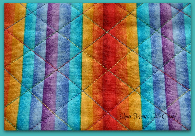 Cross hatch quilting on rainbow fabric using Sulky Blendable Thread