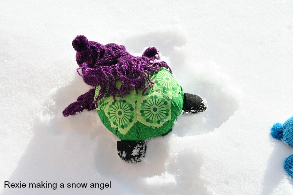 Rexie the Hexie Turtle making a snow angel.