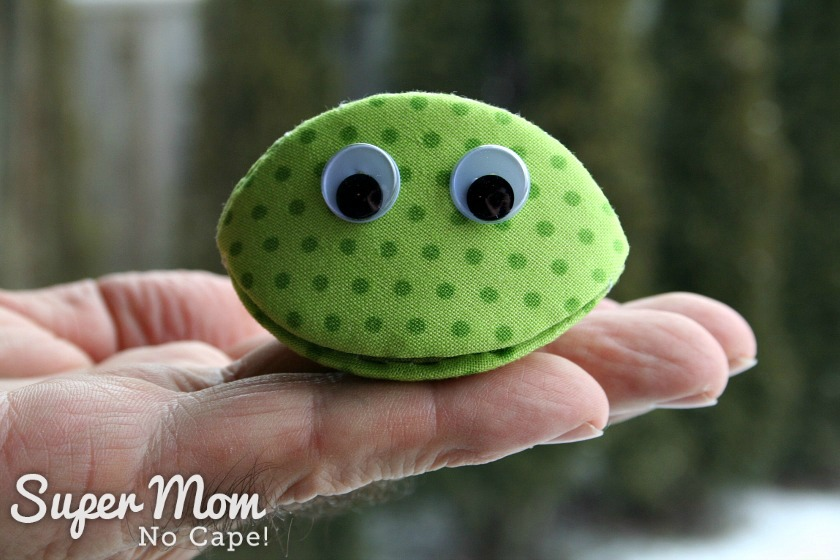 Photo of Frankie Frog made using a thimble pip being held on a man's hand