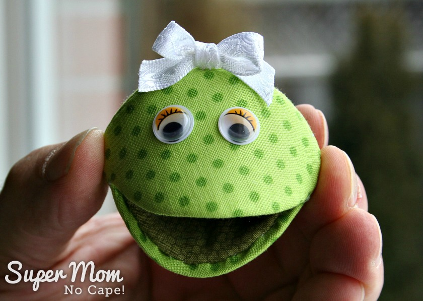 Photo of Frannie Frog with a bow on her head and a big smile