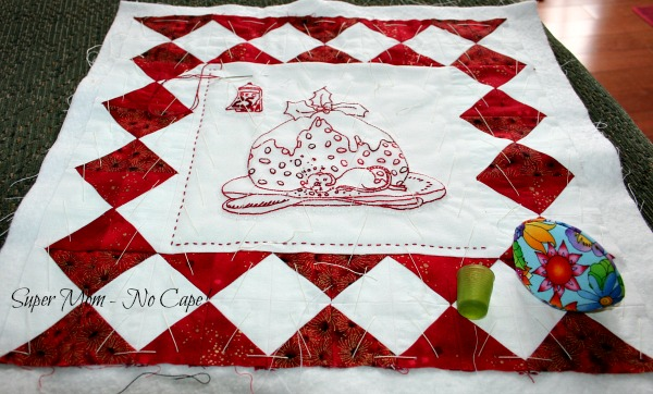 Christmas Mouse wall hanging being hand quilted.
