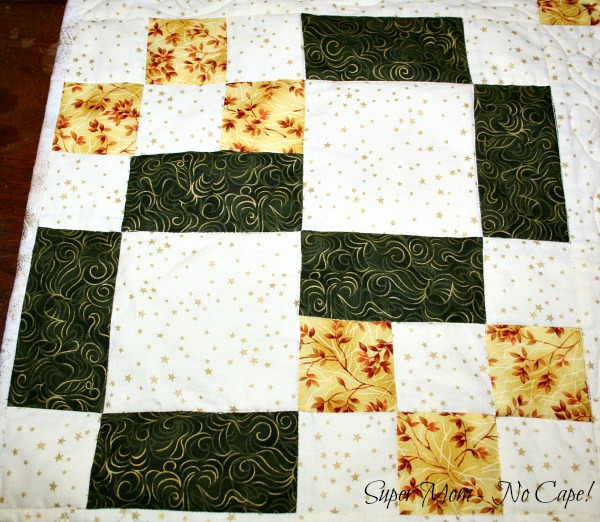 Block quilted with stitch in the ditch