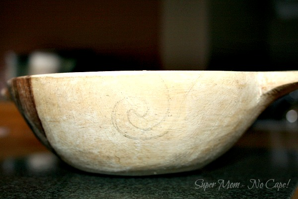 Draw desired shape on the outside of the wooden bowl.