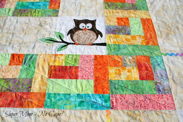 Quilting on the Half Log Cabin Blocks on Forest Friends quilt