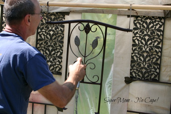 Dave spray painting the lawn chair parts.