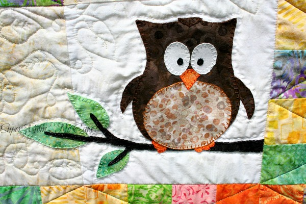 The appliqued owl on my Forest Friends quilt.