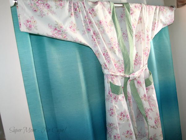 my new housecoat hanging from a shower curtain rod