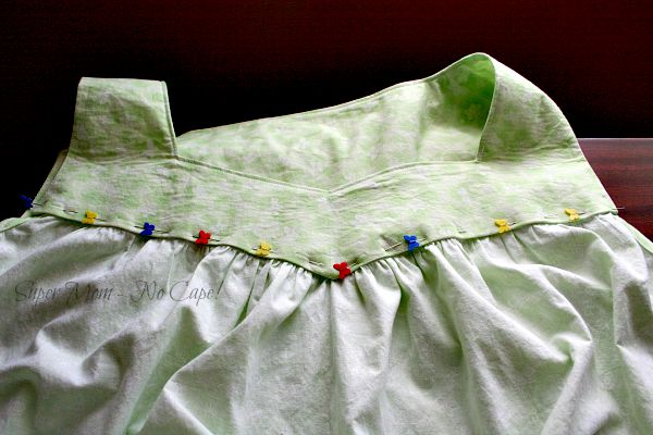 Hand stitching the inside yoke on the nightgown