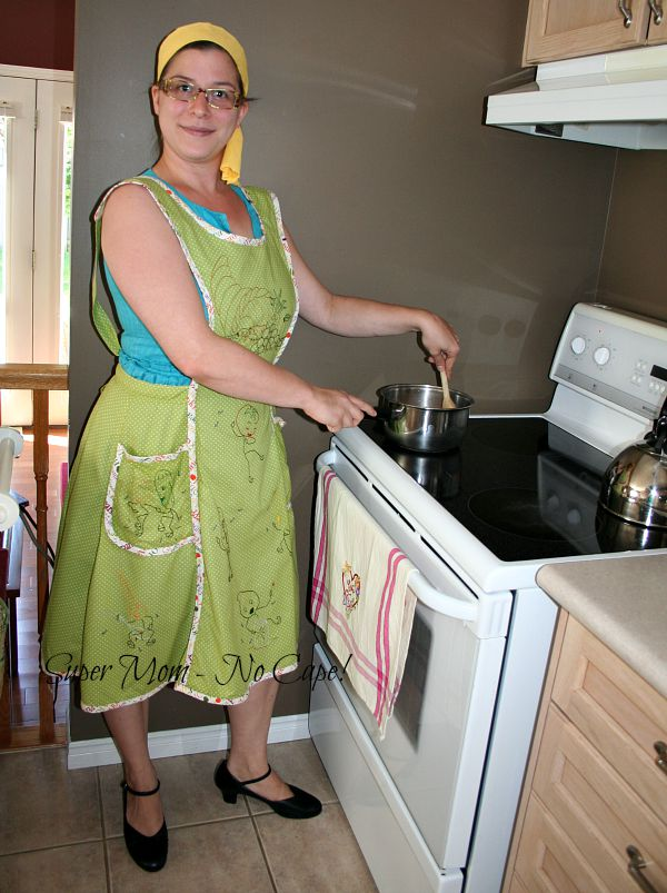 Middle daughter modeling apron 1