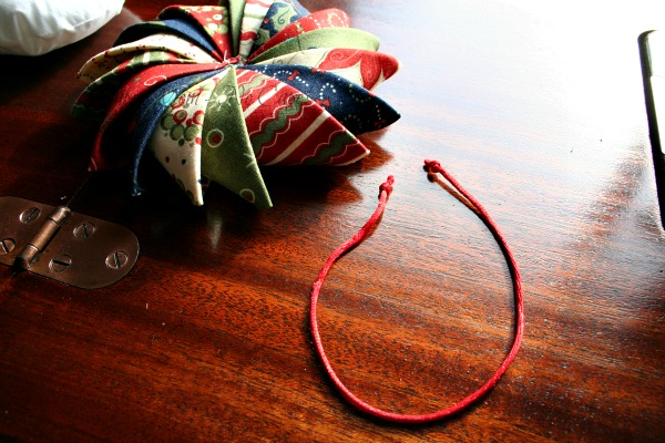 Step 15 - Cut a length of cord or ribbon 12 long and knot ends