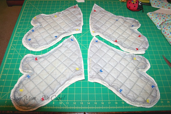 Quilted fabric cut to fit old oven mitts