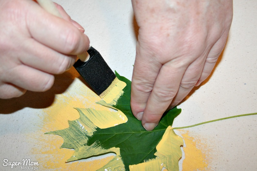 Step 2: Pulling sponge brush off the leaf onto the table runner
