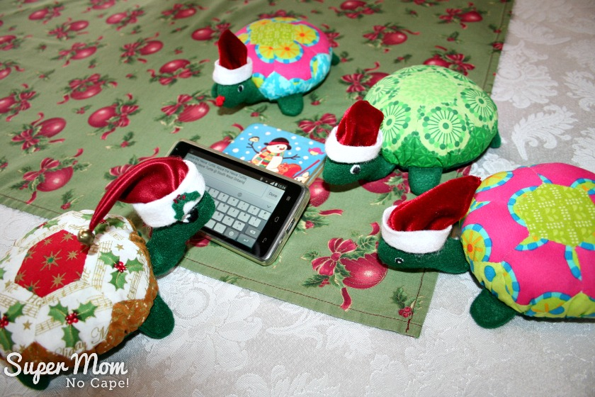 A Hexie Turtle Christmas Eve - Holly makes sure to that Santa's database is up to date.
