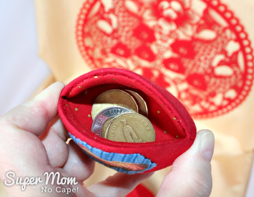 Gold coins inside of Chinese New Year Money Pips
