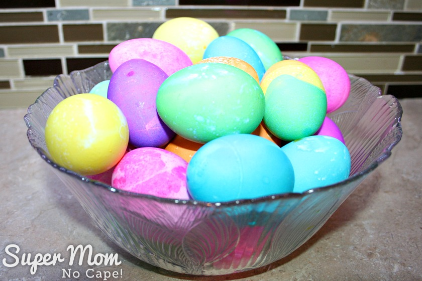 10 Delicious Ways to Use Up Hard Boiled Eggs - Easter eggs in a bowl