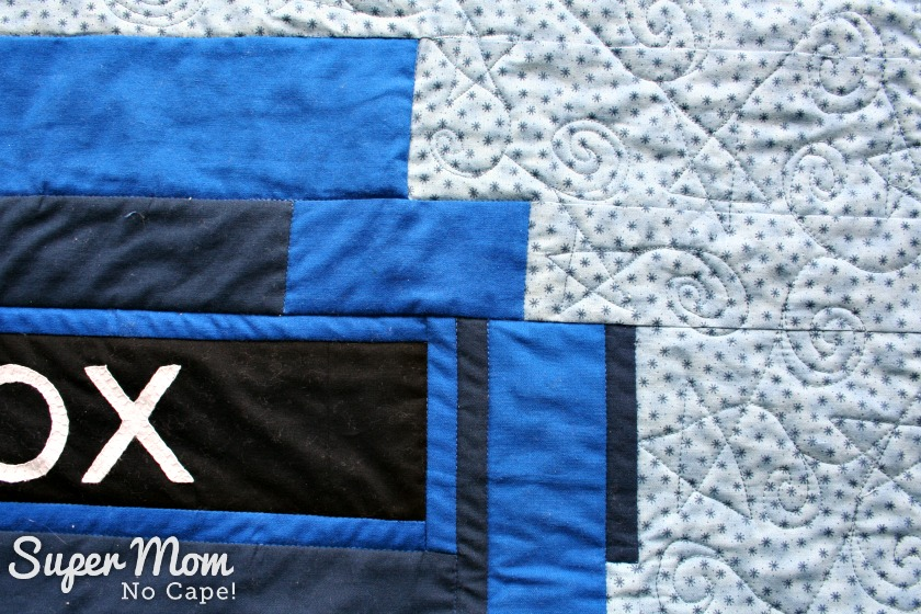 Free Motion Quilt - stars and swirls on the side borders of the Tardis Quilt
