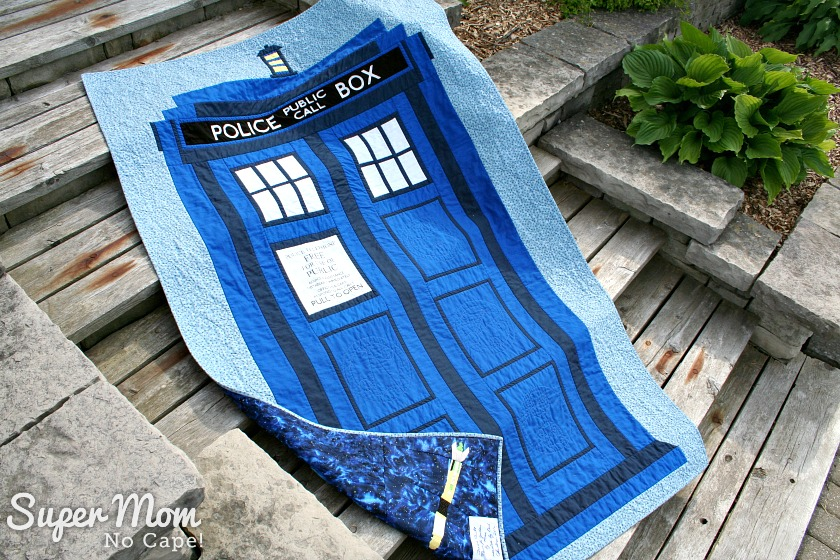 Dr Who Tardis Quilt - displayed on wooden steps