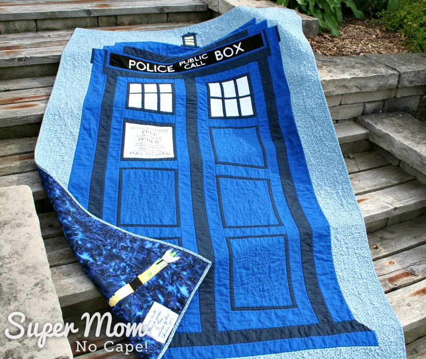 Dr Who Tardis Quilt - laying on wooden steps